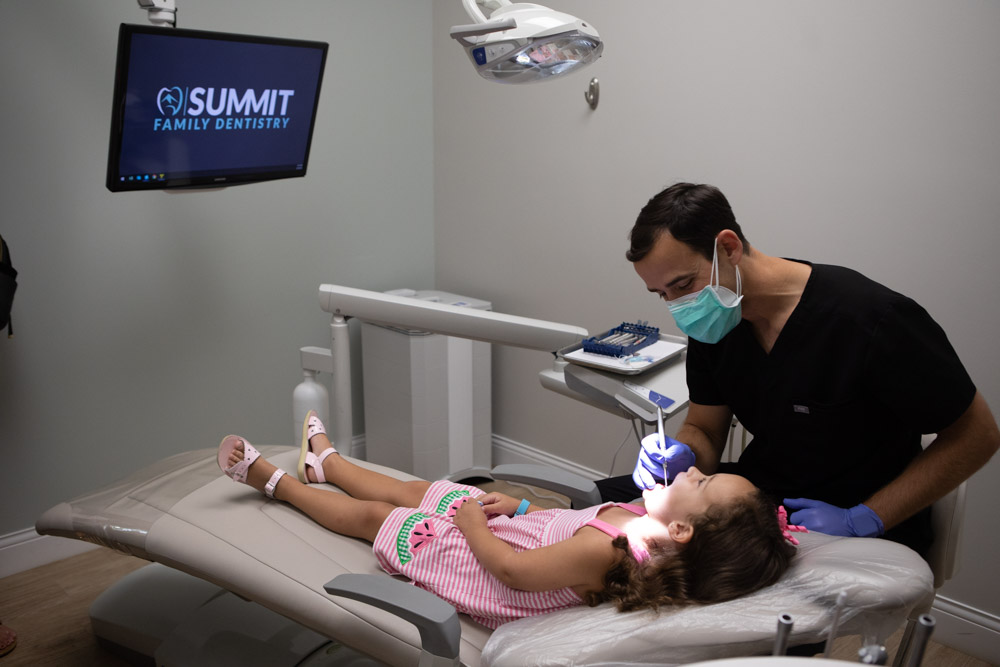 Image of Dr. Andy Pernell performing a pediatric dental checkup at Summit Family Dentistry in Denver, North Carolina