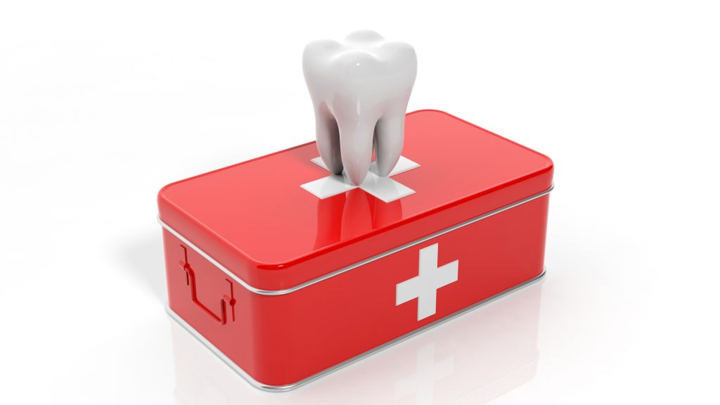 illustration of a tooth on top of a first aid kit